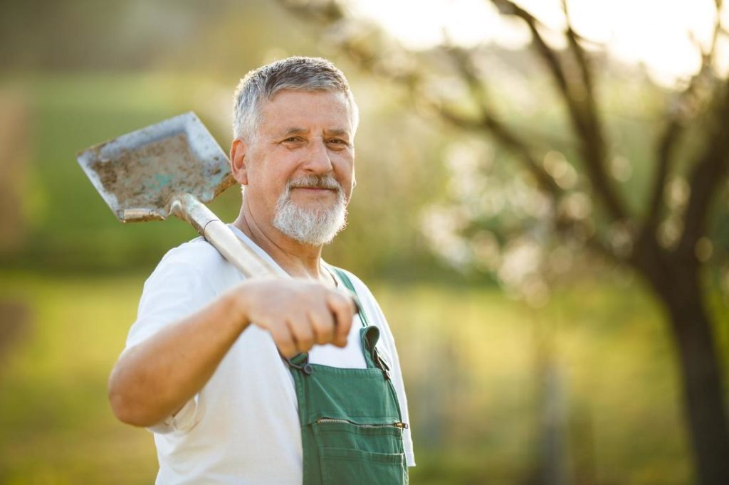 man with a shovel smiling